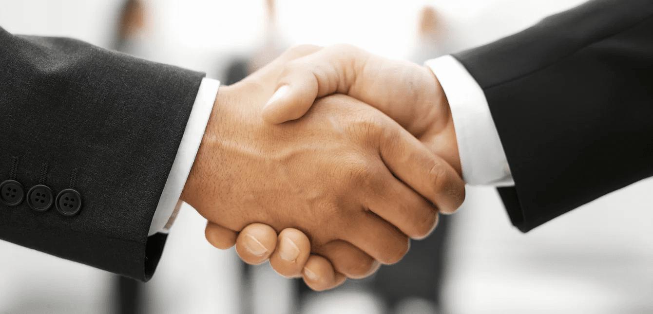 Men shaking hands business deal